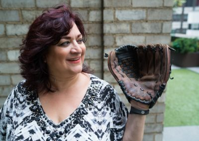 Luisa Russo with her softball glove from when she played growing up in Carroll Gardens