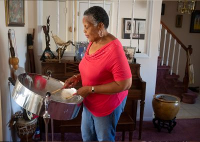 Patricia Williams is learning how to play the steel pans